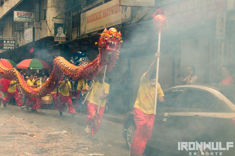 Dragon Dance in the mist of the firecracker's smoke