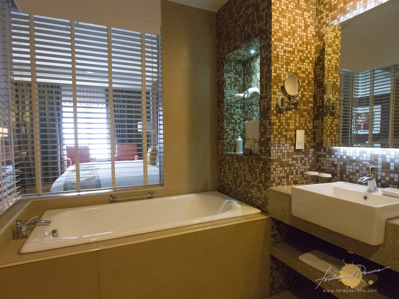 Bathroom with blinds on the Deluxe Room