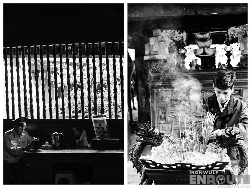 A guard and a devotee burning incense at the Temple of Literature