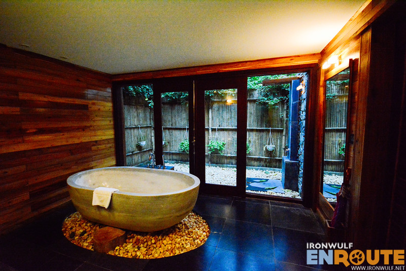 The bathroom with a marble tub and outdoor shower
