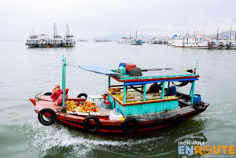 A boat vendor selling fruits