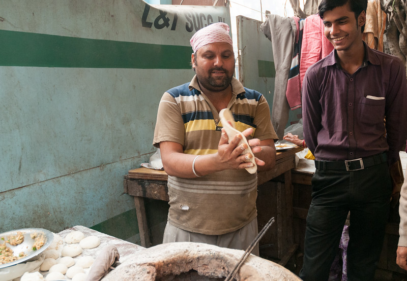 A vendor makes chappatis in a roadside stall in New Delhi.