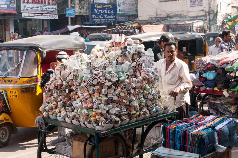 A tea-cup vendor, Charminar market area, Hyderabad.