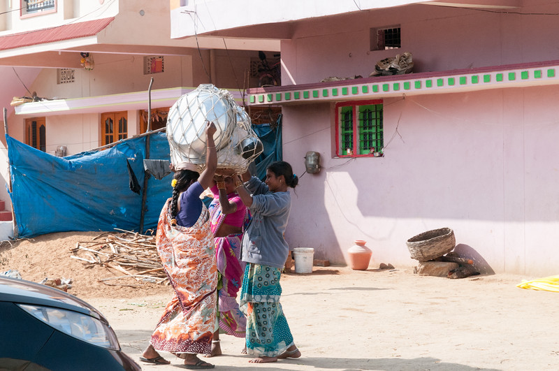 Village of Rajballaram - a door-to-door pot saleswoman packs up to move on to the next house.