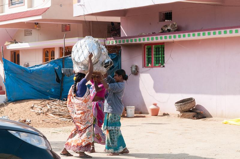Village of Rajballaram - a door-to-door pot saleswoman packs up to move on to the next house.