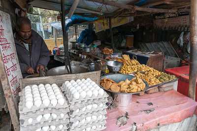 A vendor of fried snacks along the street in New Delhi.