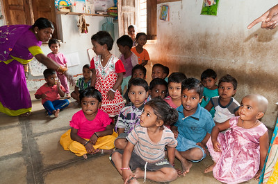 Teachers assemble the children in a government-run children's center. Village of Rajballaram, near Hyderabad.