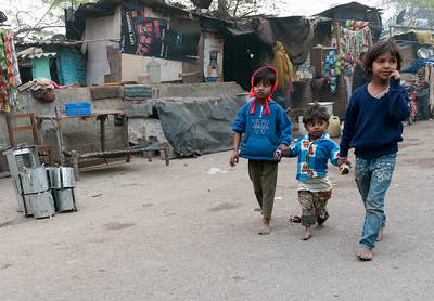 Three children on a back road in southwest New Delhi.