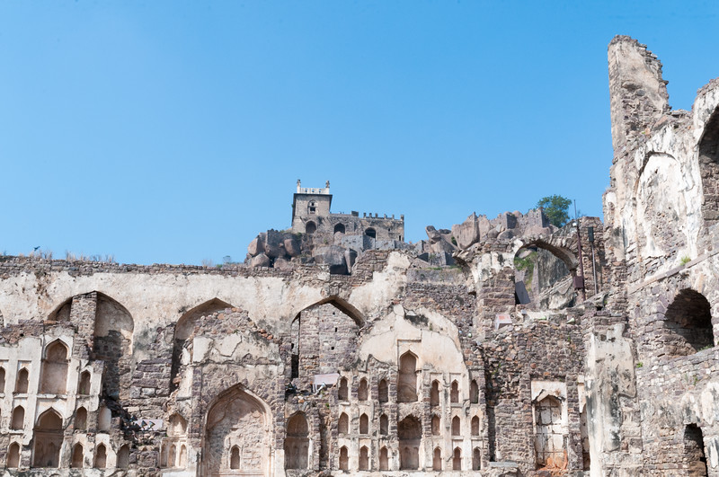 Golconda Fort - although the roofs are long destroyed, you can sense the scale of this portion of the palace, with the hilltop fort at rear. Hyderabad.