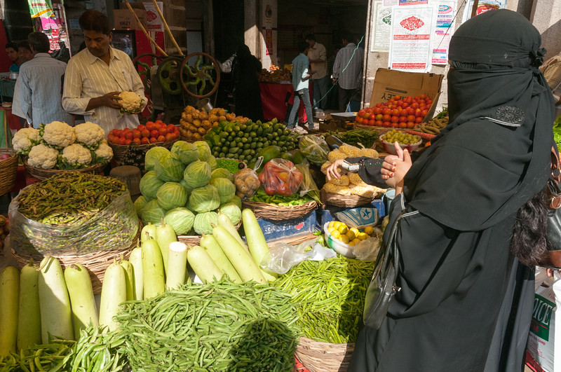 A woman buying vegetables in the Charminar market area, Hyderabad.