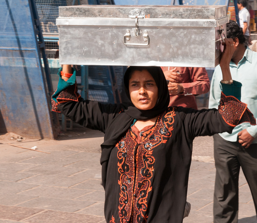A woman who had just purchased a new chest in the Charminar market area, Hyderabad.