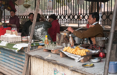 A sidewalk snack vendor in New Delhi.