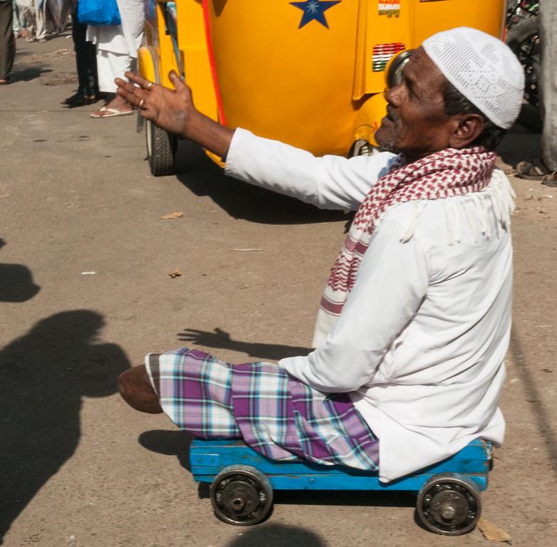 A beggar in the Charminar market area, Hyderabad.