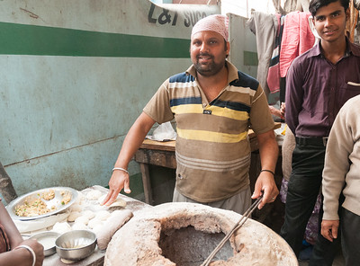 A vendor makes chappatis in a roadside stall in New Delhi.