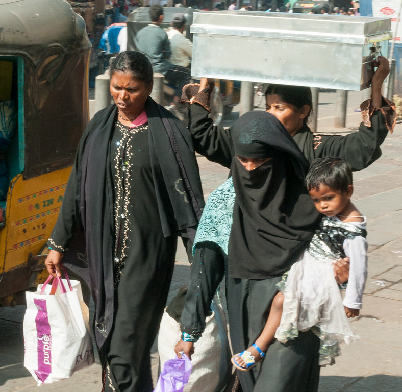 Women and child return from shopping in the Charminar market area, Hyderabad.