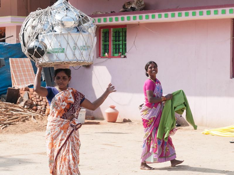 A door-to-door pot saleswoman bids good-by to customers. Village of Rajballaram, near Hyderabad.