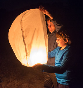 David and Andy launch  a Chinese balloon on the beach at Kiawah. Photo by Jack Kotz.