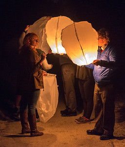 Isabel and John launch a Chinese balloon on the beach at Kiawah. Photo by Jack Kotz.