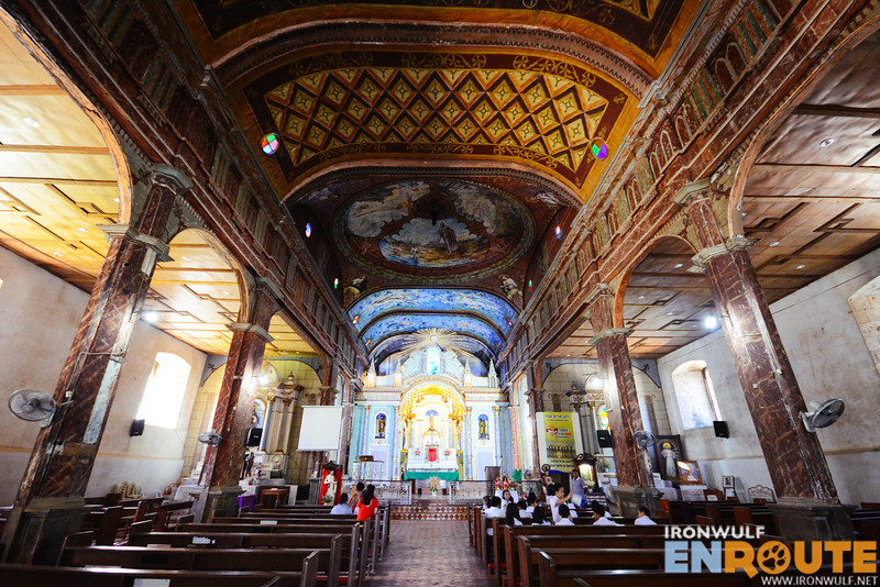 Beautiful church interior from the floor tiles, wooden columns and ceiling paintings