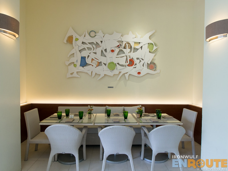 A dining corner at Pico Restaurant, I love how the bare spaces are accentuated by art pieces
