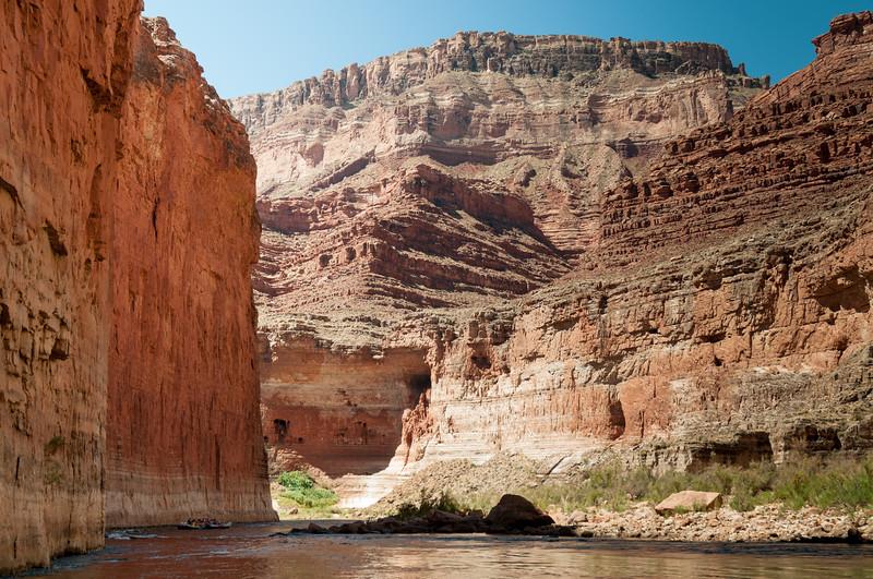 Lead boat is dwarfed by cliffs