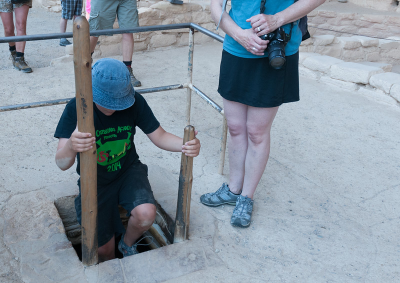 Andy enters a kiva - Spruce Tree House