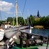 Old boats and mechanics in the prime leisure boat area in old Stockholm.