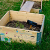 School project planting boxes within the Rosendals gardens. A grassy area was set aside with about 50 of these boxes.
