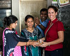 Heather receives a stuffed turtle at the Global Communities center in Ramoshi Ali, a Pune slum.