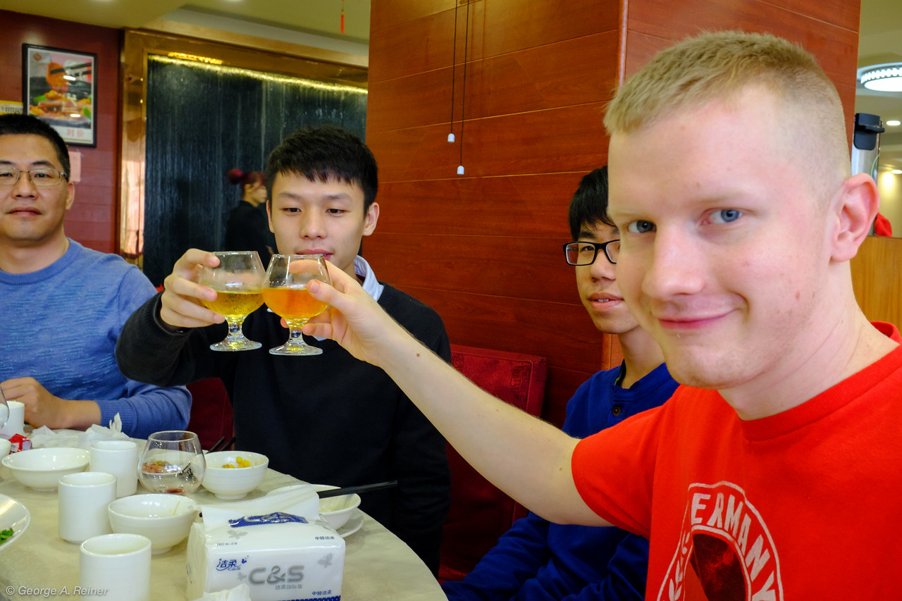 """John and Jason (Vince's cousin) toasting the fact that there is no drinking age in China.  Jason explained that a popular after school activity for middle schoolers is to stop by the bar.  He also didn't get the concept of binge drinking or drinking to just get wasted.  """"Why wouldn't you want to be in control of yourself?"""""""