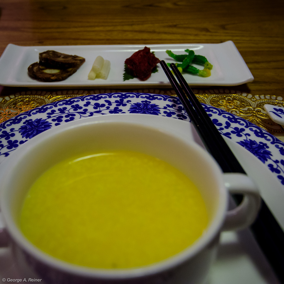 Corn soup and appetizers (beef, bamboo, fish & mini pickles).