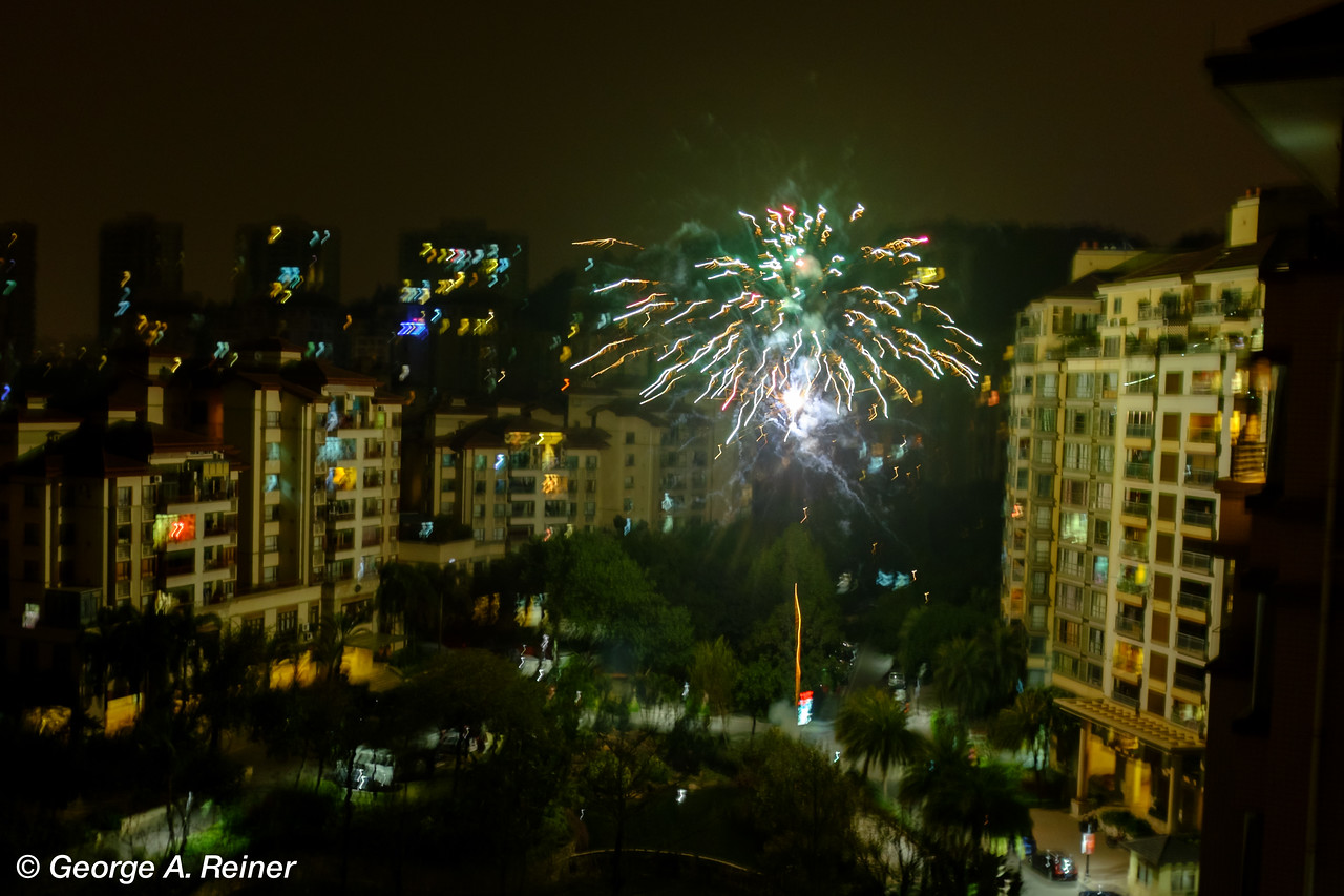 Pardon the bad photos... I couldn't pack a tripod.  This is handheld and shows how close fireworks are set off near buildings for the New Year celebration.  The burst is maybe 150 yds from our balcony.