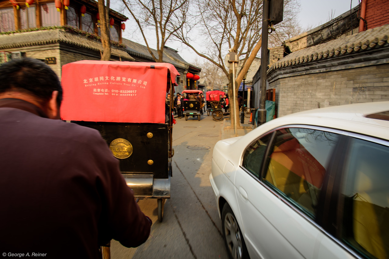 This area is adjacent to the place we dined our first night in Beijing.  The streets are very narrow and lots of competing traffic.