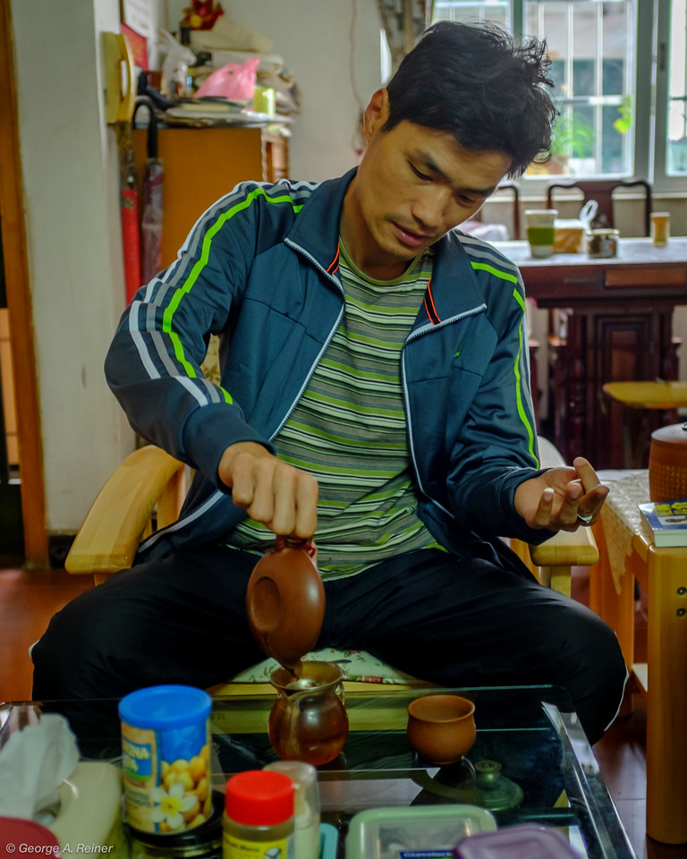 "Fei is the tea master... he knows more about tea than anyone I know.  Here he is brewing a puer tea made from ""old growth trees"".  It had a very light fragrant note.  I still remember his tea education from a couple years ago."