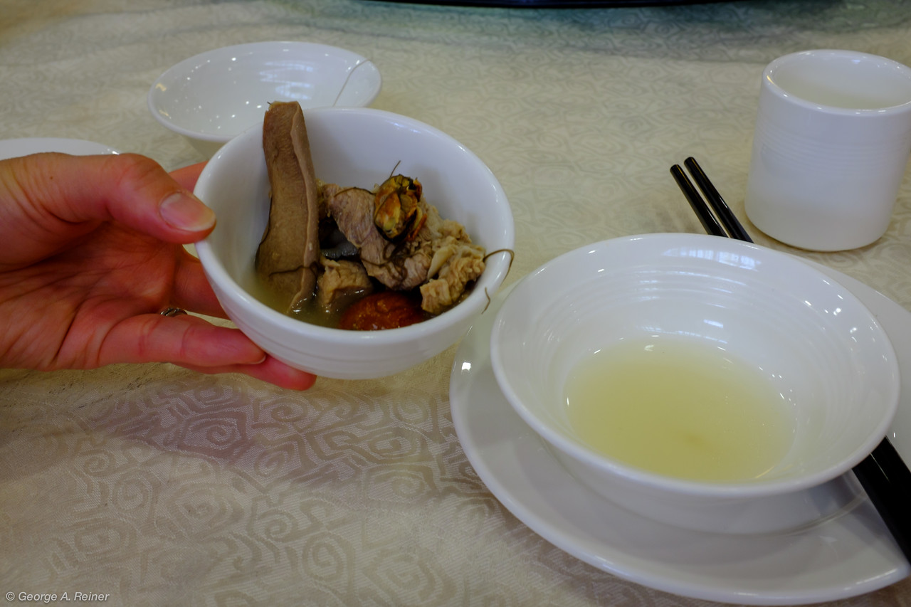 Clear soup made from pork tongue, dry oyster, pork, chicken (and maybe some other stuff).  Drinking it is supposed to bring us luck.