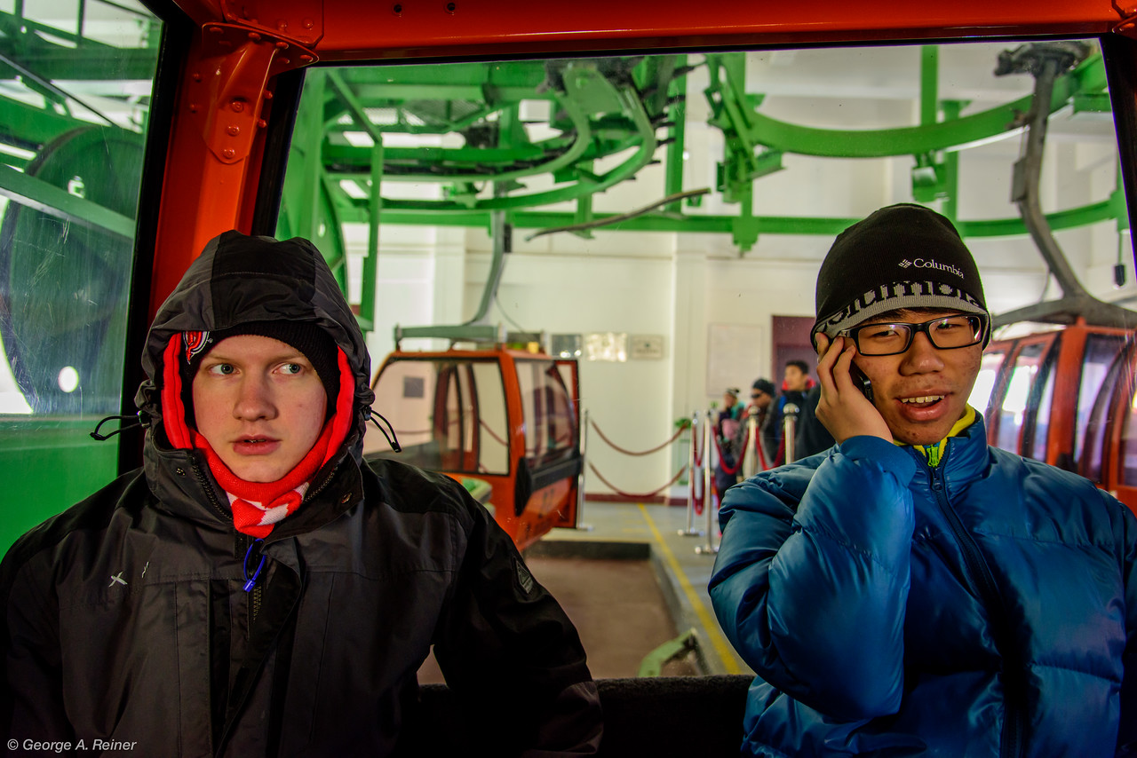 In the cable car...