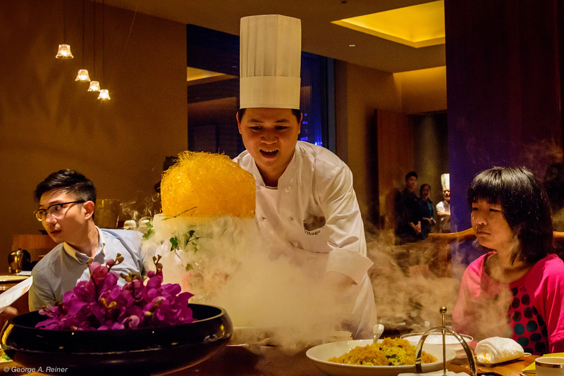 """The chef presents his dessert tray... served with an edible """"birds nest"""" above the dry ice."""