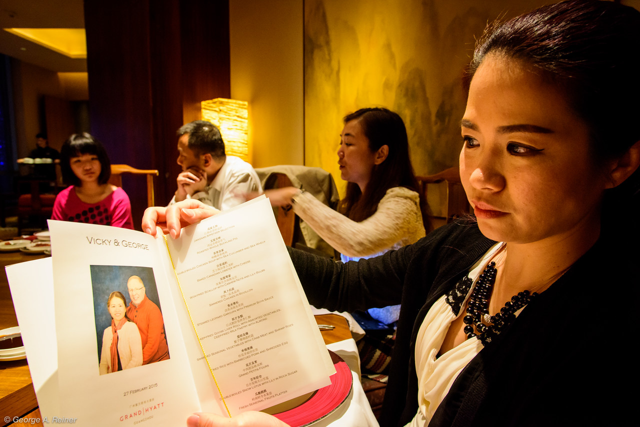 Vicky shares the menu... the soloist and her parents (the MCs) are in the background.