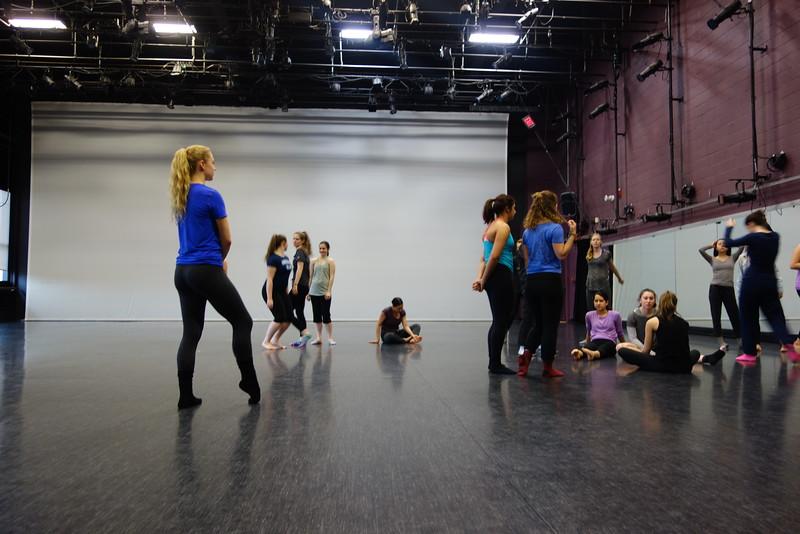 Kelli warming up to join a modern dance class