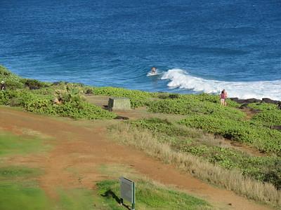 Point at Poipu surfer