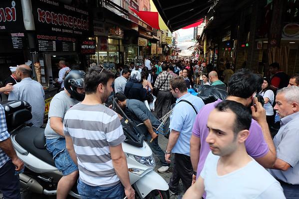 Vespa winding its way through pedestria alleys outside Spice Market