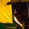 Boy in tuk tuk at night, Delhi, India