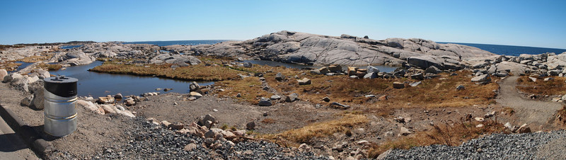 Large boulders composed of 415-million-year-old Devonian granite, called glacial erratics, were lifted by the ice and carried for long distances before being deposited upon the landscape as the ice receded, leaving rugged barrens.