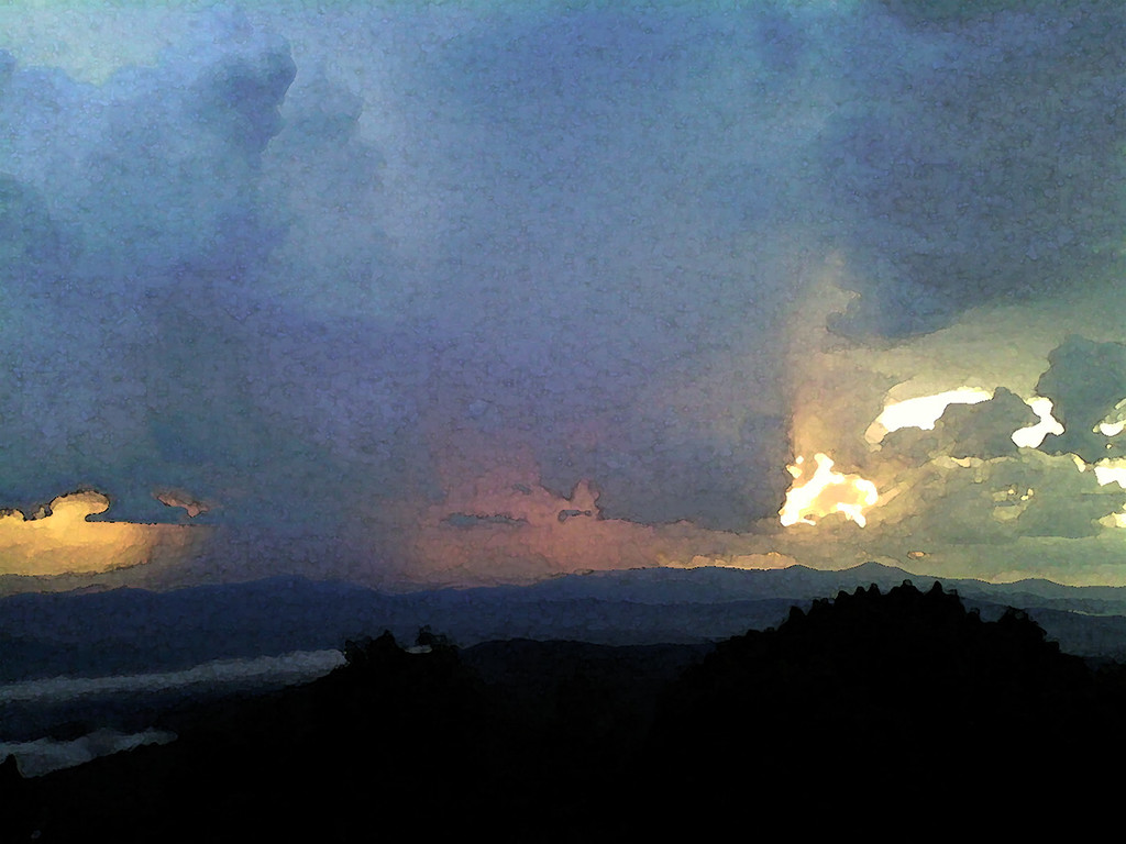 June 17, 2015, our first day in the Blue Ridge, friends Lib and Hermann drove Jodi and me just before sunset to Jump Off Rock in Laurel Park west of Hendersonville. When we got there a thunderstorm was obviously raining on Etowah, a town in a valley among the ridges. My camera was back in our motorhome, so I snapped a photo with my dumb phone's little camera and processed it to make it appear as a water color.