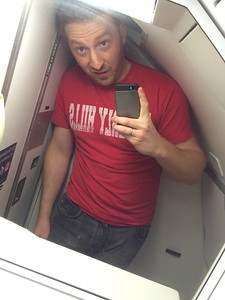 Niel fits so well in airplane bathrooms.  And this was before the delay that caused us to cancel the SLC Wedding Dinner!