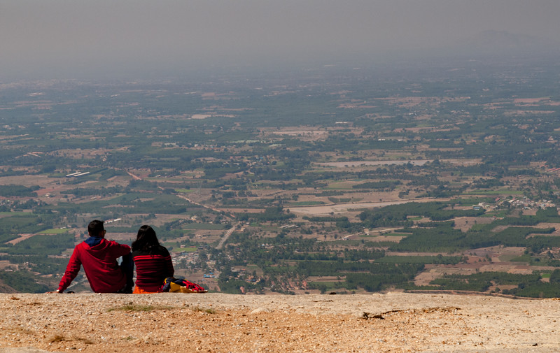 A couple enjoys the (hazy) view from Nandi Hills, outside Bangalore.