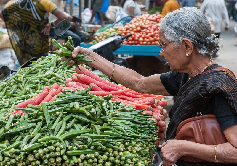 A woman buys okra near 8th cross, Sampige Rd, Bangalore