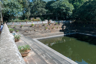 A woman views the 100-year-old stepped water storage tank, Nandi Hills, outside Bangalore.