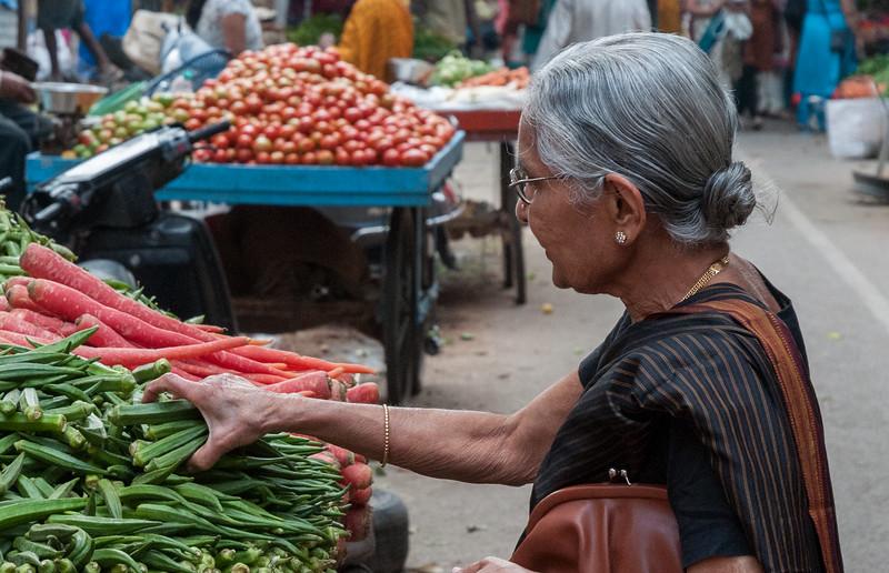 A woman buys okra near 8th cross, Sampige Rd, Bangalore
