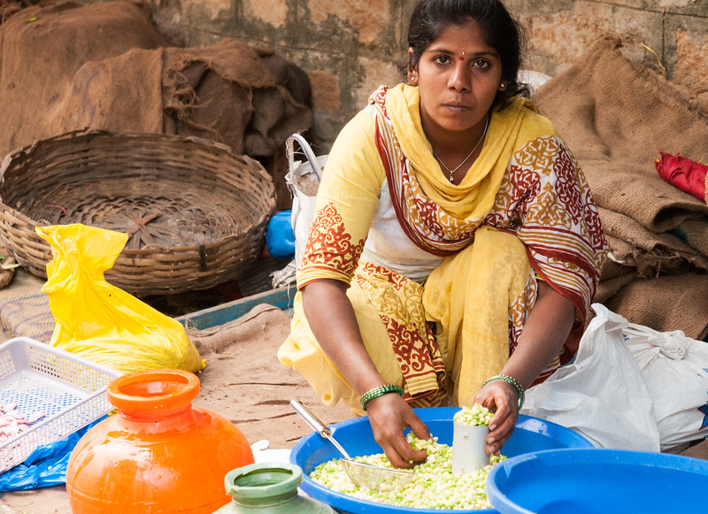A woman sells fresh beans at the market near 8th cross, Sampige Rd, Bangalore